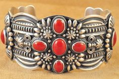 Handmade cuff bracelet, with natural red coral, by Navajo artist Darrell Cadman.