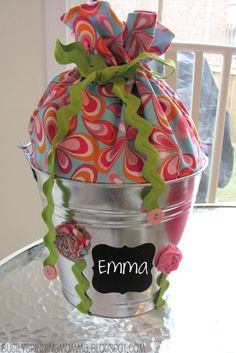 """Adorable way to """"wrap"""" a baby shower gift, that is also re-usable for around the house."""