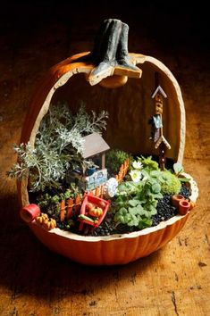 Fairy Garden made in a cut-away paper mache pumpkin.  You could also use one of the plastic pumpkins sold in Michael's or AC Moore