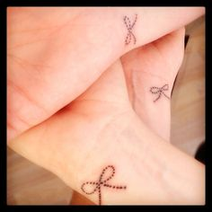 Sisters bow tattoo. Size of a quarter, dotted to create a cute little bow.  Love you sisters! -Rach