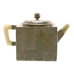 A Yixing Pewter-Encased Teapot The square form body is incised with a three-verse poem, and reversed with a pine tree, with jade handle and spout, and a later silver lid. Qing Dynasty #AsianTeaPot