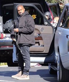 Kanye West wearing the adidas Yeezy 750 Boost Yeezy 750, Yeezy Boost 750, Kanye West Outfits, Kanye West Style, Celebrity Sneakers, Yeezy Outfit, Grey Shoes, Celebrities