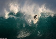 Wipeout: A surfer struggles to ride a wave at 'The Wedge' break in Newport, California. The wave become particularly popular when it is hit by a large a swell