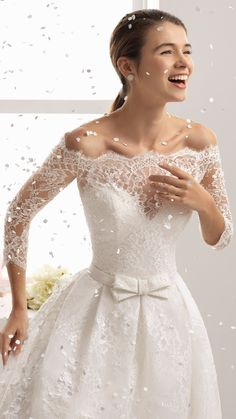 BESAI wedding dress by Aire Barcelona. A flawlessly romantic look makes for a happy bride! This off-the-shoulder ball gown comes with three-quarter lace sleeves for a timelessly elegant touch. @airebarcelona #AireBarcelona #AireBarcelona2018 #weddingdress #weddinggown #romantic #ballgown #lace #weddingdresses #bridal #wedding #sponsored