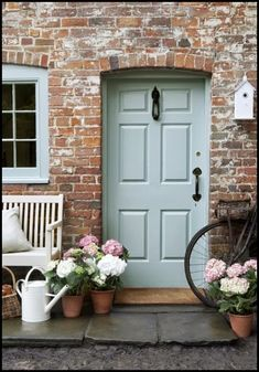 Baby Blue door and window on a brick house. Love the accent pieces in white.
