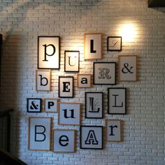 Love the different frames and fonts. Decor in Pull & Bear retail store, Barcelona.