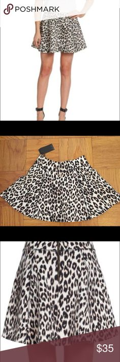 "NWT PJK PATERSON J. Kincaid leopard print skirt S NWT PJK PATERSON J. Kincaid leopard print exposed zipper skirt. Size Small. 15"" long. Viscose / Nylon/ Spandex. Thick material. Amazing quality. Purchases from Saks. Patterson J. Kincaid Skirts Mini"