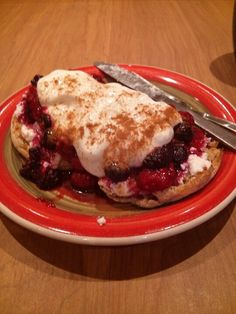 Weight watchers inspired... toasted whole wheat english muffin topped with low fat ricotta, warmed fresh berries, a dollop of greek yoghurt mixed with vanilla and sprinkle of cinnamon...almost like a cheesecake for breakfast...