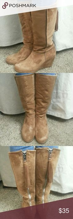 """NWT Wedge knee high boots """"Faith"""" wedge boot in Cognac, by Massini These are so soft! They have a fuzzy soft outside and a sherpa lining. There is a thick zipper all the way up the back of the boot ending in a fun tassel.  They are surprisingly comfortable and warm. The first three photos are my pair so are a little broken in. The pair  for sale is brand new in the box, with tags. Man made materials rubberized sole.  Shaft is 13""""  5"""" across with 3.5"""" wedge heel 1""""sole Massini Shoes Heeled…"""