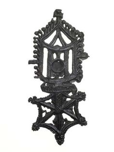 Pilgrim badge from the shrine of Our Lady of Walsingham at Walsingham Priory. This open work badge depicts the phial of the Virgin Mary's Holy Milk, which was on display at the shrine. Late medieval, mid to late 14th century.