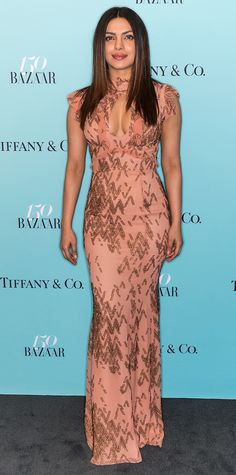 Priyanka Chopra was a stunner in this peach gown featuring a keyhole neckline, allover beaded detailing, and just the tiniest hint of frills.