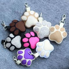 A funny creamy and brown keychain ready to guard your keys. It can also hanging from your bag or your jeans. It is perfect for dog lovers.  It is really soft, stuffed and made of resistant felt. Its totally handmade.  This keychain measures 14 cm (5,5 in). The size of a pawn is 8cm (3,2 in) This item handmade sewn and filled with fiber. It will be the perfect pal for your keys!  IMPORTANT  Despite all the care given to photos, colors may be slightly different depending on Your screen…