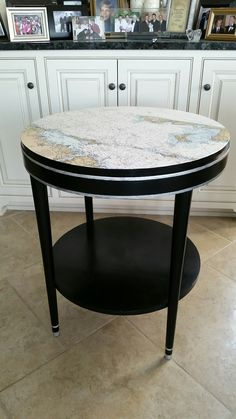 Nautical map topped table with Viva Inka gold product for striping. I did not care for the product .May redo