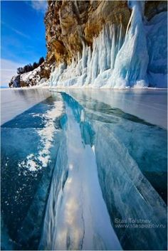 Beautiful example of the Power of Nature. The frozen Lake Baikal with rock wall. by Kay Berry