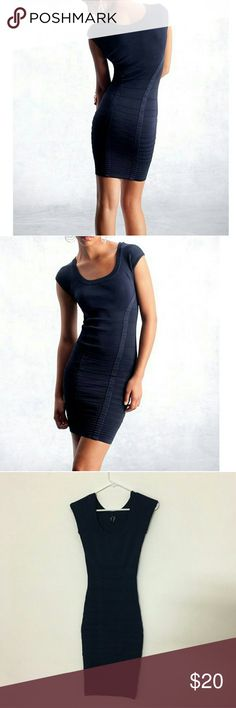 Guess by Marciano Navy bod-con Dress Stop traffic with this curve-hugging sweater dress. Horizontal piping adds definition while vertical stripes add a flattering effect.  Scoop neck. Cap sleeves. Comfortable stretch fit Slip on 85% Rayon, 14% Nylon, 1% Spandex Hand wash  Size XS = 0-2 This dress is super tight meant to be but just warning it looks amazing on & holds everything in but super tight! I wore it a few times & loved it, really sexy! Guess by Marciano Dresses