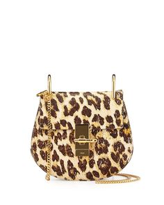 """Chloe leopard-print calfskin shoulder bag. Golden hardware. Chain shoulder strap; 22"""" drop. Flap top with turn-lock bar and chain closure. Petite saddle bag silhouette. Inside, cotton lining and open"""