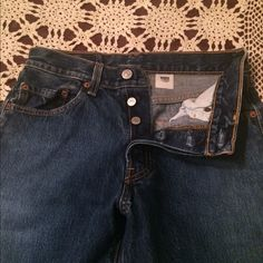 "Levi's 501 Button fly Jeans Classic Levi Strauss Button Fly 501 Jeans. Size 28 with 30"" inseam. Very good condition, no fraying at cuffs, clean, no stains or holes, and I do not put my denim in the dryer. From my non smoking home. Levi's Jeans Boot Cut"
