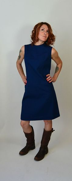 Item details    Original tags still on this stunning mod Mr George Mod Dress. Purple/Blue textured polyester with top stitching detail. This dress fits like a medium or large. All measurements taken while garment is laying flat.  shoulders 15 inches  armpit to armpit 18.5 inches (37 around)  waist 18.5 inches (37 around)  hip 19 inches (38 around)  nape to hem 38  excellent condition, original tags | Shop this product here: http://spreesy.com/coupdetatvintage/16 | Shop all of our products at…
