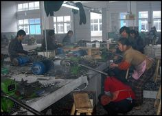 The inside of a sweatshop where clothes, toys, and furniture etc are made. These are unbearable working conditions, to work in.