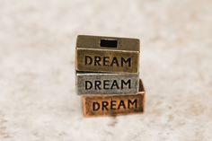 Dare to #Dream. Mix and match our word blocks to create a custom necklace.