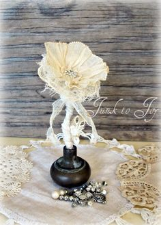 Repurpose old doorknob into a flower I have quite a few old doorknobs to do this with!  Yay!