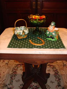 antique, lefton leprechaun planter, Longaberger shamrock basket, lucky horseshoe, green glass moon and stars compote. Visit my blog for more St Patricks day decor