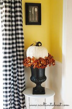 Fall decorating idea - make a fall arrangement in a urn with fall colored hydranges and top with a pumpkin