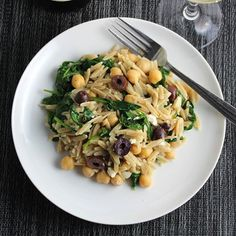 Greek style orzo tossed with spinach, olives and feta cheese makes a tasty vegetarian main course or a flavorful side dish.