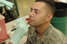 Senior Master Sgt. Jeffrey Melanson, U.S. PACOM Joint Intelligence Operations Center, receives nasal mist vaccine at the Makai Recreation Center Point of Distribution on Sept. 19. Joint Base Pearl Harbor-Hickam conducted a mass vaccination exercise in conjunction with normal flu season inoculations to demonstrate the capability to rapidly and effectively vaccinate active duty military and a selected segment of the DoD population in a pandemic environment. (Photo by MCC Donald W. Randall)