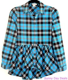 A classic plaid flannel top goes feminine, with hi-lo peplum styling and swingy softness. Covered button front. Long sleeves. Button cuffs. Color: Blue, brown, white, orange. Material: 100% Cotton.   eBay!