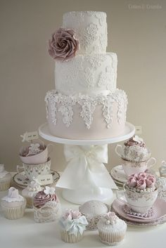 Dress inspired  wedding cake.  Presentation is perfect.  Bring the theme of your wedding (vintage classic = tea cups) to the cake table for added dimension & presentation.