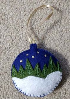 Decorating Your Home with Elegant Christmas Decorations Felt snowy woods ornament Felt Christmas Decorations, Christmas Ornaments To Make, Christmas Sewing, Homemade Christmas Gifts, Noel Christmas, Christmas Projects, Handmade Christmas, Holiday Crafts, Christmas Felt Crafts