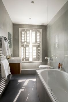 Bathroom in a contemporary Victorian terrace home in London by NS Interiors