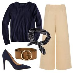 Keep this sophisticated color combo fresh by playing with silhouettes—team camel-colored culottes with a fitted navy sweater and cinch your frame with a wide leather belt. Top it off with a neck scarf for additional flair