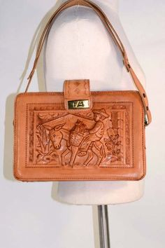 Vintage hand tooled leather bag with bird design