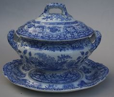 A blue and white transferware Spode Filigree pattern sauce tureen, cover and stand, c.1825. It is marked Spode to all pieces.