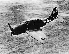 Grumman TBM Avenger  A TBM-3 Avenger from Torpedo Squadron Eighty-Two (VT-82), flying from USS Bennington (CV-20), in flight in the South Pacific area. The aircraft was damaged when the plane flying above it in formation was hit by anti-aircraft fire and fell on top of it. (U.S. Navy photo)