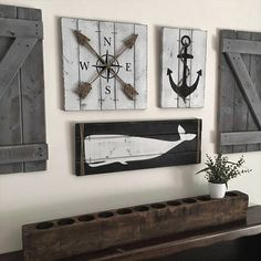 See all our nautical art here: https://www.etsy.com/shop/WoodstockRustic?ref=seller-platform-mcnav&section_id=17340252 This is a SET OF FIVE nautical art pieces - 2 barn doors, an anchor, a compass, and a whale, each with jute rope accents for a truly nautical effect! Rustic beach