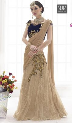 Pamper the women in you with this beige color embroidered net lehenga sari. The wonderful lace and resham work through saree is awe-inspiring. Lehenga Style Saree, Net Lehenga, Party Wear Lehenga, Lehenga Choli Online, Indian Sarees Online, Bridal Lehenga, Saree Wedding, Wedding Wear, Wedding Outfits