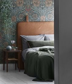 vintage inspired floral print wallpaper and a leather headboard are an ideal combo for a moody space wallpaper bedroom