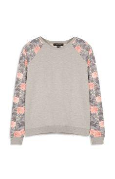 Primark - Grijze trui met bloemenprint op mouwen