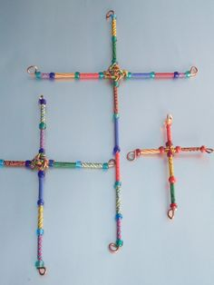 Set of Three coiled wire crosses. $26.00, via Etsy.