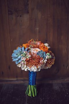 Protea and succulent bouquet- gorgeous! // image by Mishelle Lamarand Photography // see more: http://theeverylastdetail.com/2013/09/18/colorful-unique-rustic-michigan-wedding/
