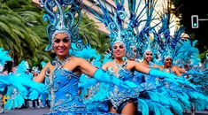 The biggest festival in the Canary Islands is the Tenerife Carnival which happens every February/March. This is your brief guide to the Tenerife Carnival. Tenerife, Canary Islands, Outdoor Decor, Feathers, Mini, Carnival, Santa Cruz, Teneriffe, Feather