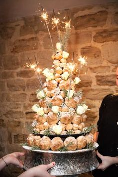 Croque-en-bouche or croquembouche or pièce montée. Alternative Wedding Cakes, Wedding Cake Alternatives, Chocolate Tree, Christmas Chocolate, Profiterole Tower, French Wedding Cakes, Fruit Christmas Tree, Cupcake Cakes, Cupcakes
