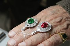 Top 10ct tsavorite and red spinel pendants with diamonds.
