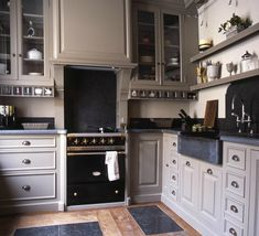 love this color on the cabinets, Lacanche french range in black; soapstone countertop; To the Manor Born: Luxe Kitchens from Baden Baden in Brussels