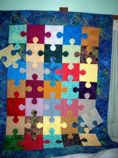 Autism Awareness Scrap Quilt.  The puzzle piece is a symbol of Autism.  The quilter did a great job, love the colors.