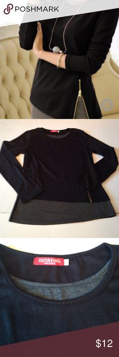 Black/Gray faux 2 piece t-shirt Black long sleeve faux two piece T-shirt. Ordered this from Lili Gal. Ordered a large but this shirt is definitely not large..... more like a small.chest is 32 , hips 32 and waist is 28.Never been worn or even tried on. ouyaying Tops Tees - Long Sleeve