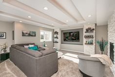 This basement remodel utilizes color to bring the space to life. It features a home theater, home gym, bathroom and wet bar. Workout Circuit At Home, Abb Workouts, Finished Basement Company, Living Area, Living Spaces, Wet Bar Basement, Construction Design, Big Houses, Basement Remodeling